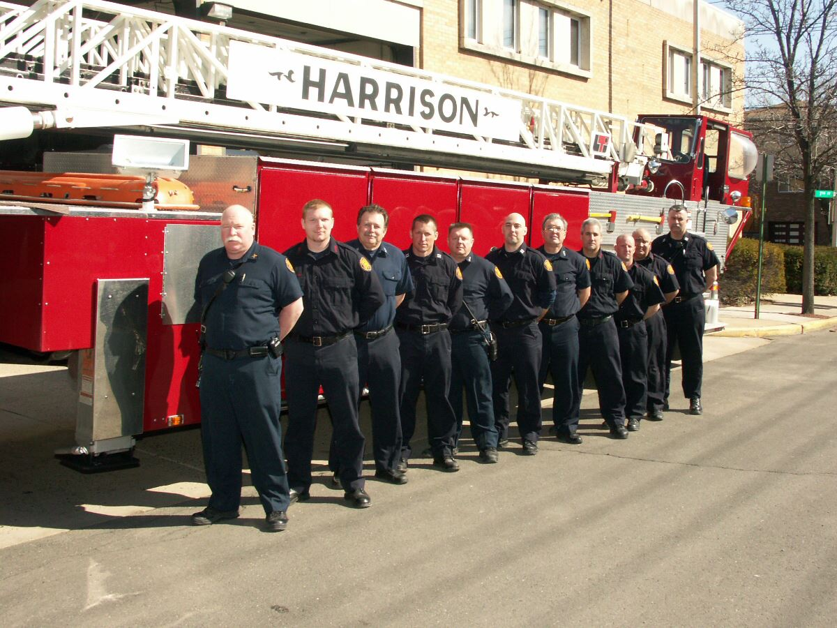 Members of Fire Department Standing Next to Fire Truck